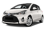 Stock pictures of low aggressive front three quarter view of a 2015 Toyota Yaris Hybride Lounge 5 Door Hatchback 2WD Low Aggressive
