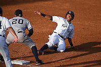 Lakeland Flying Tigers shortstop Dixon Machado (1) slides into third during a game against the Tampa Yankees on April 5, 2014 at Joker Marchant Stadium in Lakeland, Florida.  Lakeland defeated Tampa 3-0.  (Mike Janes/Four Seam Images)
