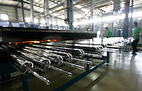 Solar thermal water heater components are seen in production at a factory owned by the Himin Group, the worlds largest manufacturer of solar thermal water heaters, which is based in Dezhou, Shandong Province, China. Dezhou, a city of 5.5 million people, is known as China's 'Solar Valley'. More than 90% of all households in the city use solar thermal water heaters. Ten cities in China have made it compulsory, or offered subsidies, for under twelve storey civil-use buildings, including residential, restaurants, and hotels to install solar thermal water heaters..