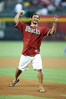 Arizona Diamondbacks guest Benson Henderson, lightweight boxer, throws out a first pitch before a National League regular season game against the Colorado Rockies at Chase Field on October 2, 2012 in Phoenix, Arizona. Arizona defeated Colorado 5-3. (Mike Janes/Four Seam Images)