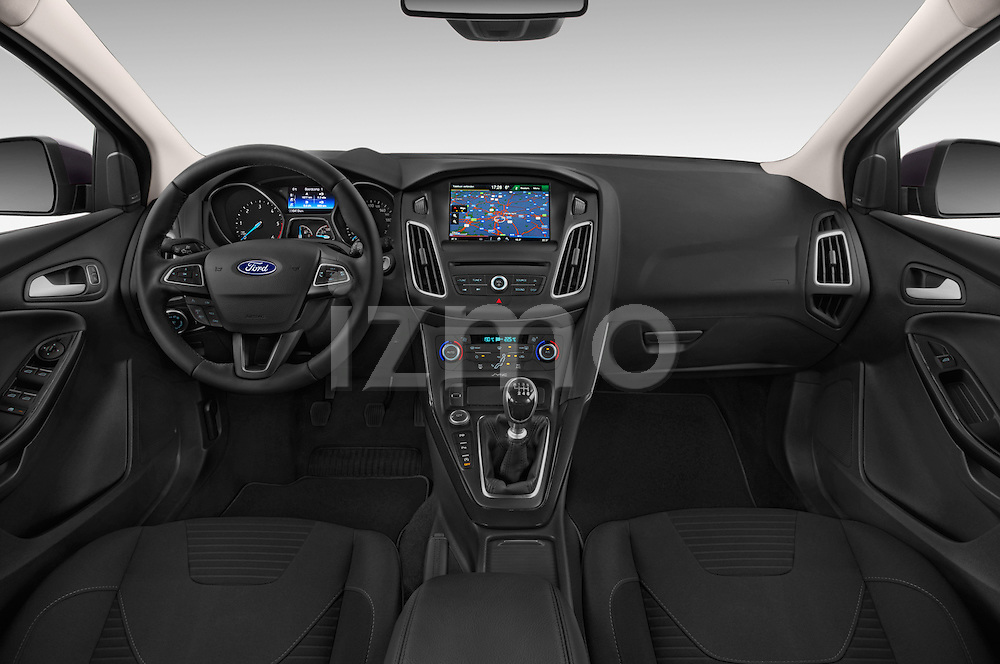 Stock photo of straight dashboard view of a 2015 Ford Focus Titanium 5 Door Wagon Dashboard