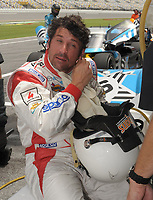"""DAYTONA BEACH, FL - JULY 03, 2008:  Actor Patrick """"McDreamy"""" Dempsey looks very over heated as he takes practice in the blistering Daytona heat at the Rolex Series BRUMOS PORSCHE 250 at Daytona International Speedway on July 03, 2008 in Daytona Beach, Florida. <br /> <br /> People:  Patrick Dempsey"""