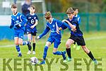 Nathan Cronin Killarney Athletic and Seamus de Hora Dingle Bay Rovers in action in Killarney on Saturday