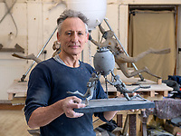 BNPS.co.uk (01202 558833)<br /> Pic: PhilYeomans/BNPS<br /> <br /> Scaled down bronze maquette's will also be produced to help raise funds.<br /> <br /> The fine art of surfacing -  Artist Mark Richards has gone to extraordinary lengths to create a lifelike 'floating' sculpture in tribute to Royal Navy mine and bomb clearance divers to be installed at Gunwharf Quays in Portsmouth next year.<br /> <br /> In an attempt to replicate the feeling of being submerged Mark suspended himself with ropes and pulleys, photographed a Navy drysuit in a local swimming pool, and reproduced in minute detail all the equipment used by brave service personnel in their perilous work.<br /> <br /> The completed sculpture will now be scaled up to 1.25 life size and cast in bronze at Morris Singer foundry in Hampshire.