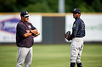 Pulaski Yankees pitcher Alexander Vizcaino (57) warms up in front of pitching coach Gerardo Casadiego (55) before a game against the Greeneville Reds on July 27, 2018 at Pioneer Park in Tusculum, Tennessee.  Greeneville defeated Pulaski 3-2.  (Mike Janes/Four Seam Images)
