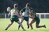 Mark Selwyn gets a backhand pass away as Gary Dalbeth and Joshua Baverstock stop his run. Counties Manukau Premier Club Rugby game between Pukekohe and Manurewa, played at Colin Lawrie Fields, Pukekohe, on Saturday May 28th, 2016. Pukekohe won the game 62 - 18 after leading 19 - 10 at halftime. Photo by Richard Spranger.