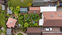 BNPS.co.uk (01202) 558833. <br /> Pic: BNPS<br /> <br /> Pictured: Mike Clifford's exotic garden. <br /> <br /> A gardener who spent years cultivating some of the world's rarest plants is opening his exotic bungalow garden for charity. <br /> <br /> Mobile home designer, Mike Clifford, began tropical gardening over 20 years ago when he was inspired by a documentary on the subject.  <br /> <br /> Since then, he and his wife Tina, who makes cakes for visitors, have cultivated thousands of plants from across the globe in their quaint English garden.