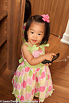 18 month old toddler girl playing with cell telephone