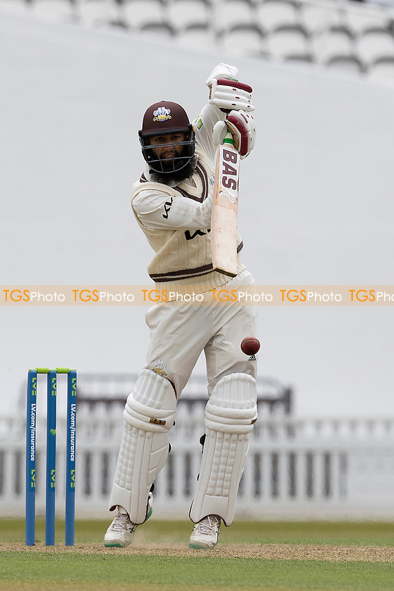 Hashim Amla of Surrey CCC eases the ball through extra cover for four runs during Surrey CCC vs Hampshire CCC, LV Insurance County Championship Group 2 Cricket at the Kia Oval on 30th April 2021