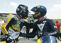 Danny Eslick. left, and Cory West talk after a race at the AMA Superbike Showdown at Road Alanta, Braselton, GA, April 2010.  (Photo by Brian Cleary/www.bcpix.com)