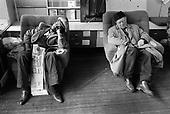 Two men sleeping in the reception area of the 510 Community Centre, Harrow Road, North Paddington, London.