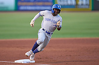 Dunedin Blue Jays Justin Ammons (3) rounds third base during a game against the Clearwater Threshers on May 18, 2021 at BayCare Ballpark in Clearwater, Florida.  (Mike Janes/Four Seam Images)