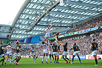 Luke Thompson of Japan rises high to win lineout ball. Rugby World Cup Pool B match between South Africa and Japan on September 19, 2015 at the Brighton Community Stadium in Brighton, England. Photo by: Patrick Khachfe / Stewart Communications