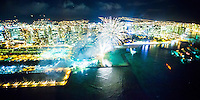 An aerial view of fireworks at Hilton Hawaiian Village, Waikiki, with Ala Wai Harbor to the left, O'ahu.