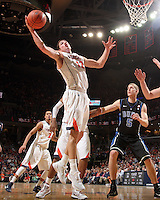 Feb. 16, 2011; Charlottesville, VA, USA; Virginia Cavaliers guard Joe Harris (12) gets the rebound in front of Duke Blue Devils forward Mason Plumlee (5) during the second half of the game at the John Paul Jones Arena. The Duke Blue Devils won 56-41. Credit Image: © Andrew Shurtleff