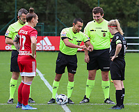 Captain Maud Coutereels (17) of Standard, assistant referee Olivier Jacques, referee Mehdi Sayoud, assistant referee Romain Deltree and captain Jana Simons (8) of Woluwe at the coin toss before a female soccer game between Standard Femina de Liege and White Star Woluwe on the fifth matchday of the 2021 - 2022 season of Belgian Scooore Womens Super League , saturday 2 nd of October 2021  in Angleur , Belgium . PHOTO SPORTPIX   SEVIL OKTEM