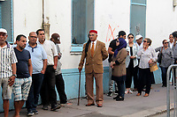 TUNIS, TUNISIA - OCTOBER 6: Tunisians wait in line to cast their vote at a polling station during the parliamentary elections in Tunis, Tunisia on October 6, 2019