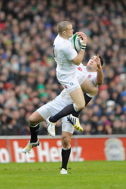 Confusion in defence as Mike Brown (left) and Brad Barritt of England both jump for the high ball during the RBS 6 Nations match between Ireland and England at the Aviva Stadium, Dublin on Sunday 10 February 2013 (Photo by Rob Munro)