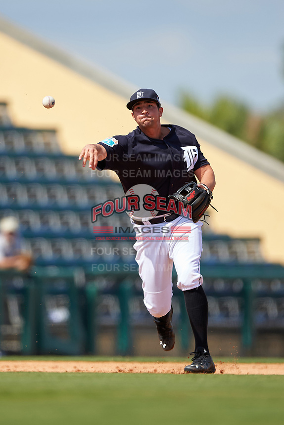 Detroit Tigers third baseman Nick Castellanos (9) throws to first base during an exhibition game against the Florida Southern Moccasins on February 29, 2016 at Joker Marchant Stadium in Lakeland, Florida.  Detroit defeated Florida Southern 7-2.  (Mike Janes/Four Seam Images)
