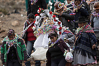 A picture dated Saturday January 26, 2013 shows a group of women and miners carrying an image of Virgin Patron at the Miners Carnival in the Andes city of Potosi in Bolivia. Already in 1663 the Spanish chronicler Marquez Jerez de los Caballeros described the colorful  miners carnival in Potosi. Four centuries later, the tradition of the legendary Cerro Rico miners is  still alive ..