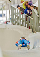 5 December 2014: Shiva Keshavan, sliding for India, crosses the finish line on his first run, ending the day with a 25th place finish and a combined 2-run time of 1:45.728 in the Men's Competition at the Viessmann Luge World Cup, at the Olympic Sports Track in Lake Placid, New York, USA. Mandatory Credit: Ed Wolfstein Photo *** RAW (NEF) Image File Available ***