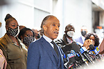 """Reverend Al Sharpton, center, speaks at a press conference in response to the George Floyd and Duante Wright cases along with Sybrina Fulton, mother of Trayvon Martin, left, and Sequette Clark, Mother of Stephon Clark, left of center, after the """"Mother's of the Movement"""" panel at the National Action Network (NAN) Virtual Convention 2021 in New York on Wednesday, April 14, 2021. Photograph by Michael Nagle"""