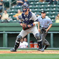 Catcher Peter O'Brien (9) of the Charleston RiverDogs waits for a throw for a play at the plate in the bottom of the seventh inning of a game on Saturday, April 6, 2013, at Fluor Field at the West End in Greenville, South Carolina. Charleston went on to win Game 1 of a doubleheader, 6-2. (Tom Priddy/Four Seam Images)