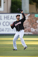 Kannapolis Intimidators left fielder Nick Basto (14) catches a fly ball during the game against the Greensboro Grasshoppers at CMC-Northeast Stadium on June 11, 2015 in Kannapolis, North Carolina.  The Intimidators defeated the Grasshoppers 7-6.  (Brian Westerholt/Four Seam Images)