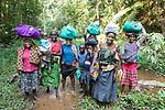 Woman & Boys Traveling From Mutanda Lake