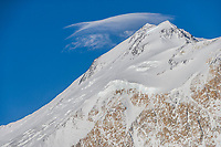 Aerial of lenticular clouds capping the north peak of Denali viewed from the west side.
