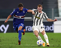 Calcio, Serie A: Juventus - Sampdoria, Turin, Allianz Stadium, September 20, 2020.<br /> Juventus' Delan Kulusevski (r) in action with Sampdoria's Bartosz Bereszynski (l) during the Italian Serie A football match between Juventus and Sampdoria at the Allianz stadium in Turin, September 20,, 2020.<br /> UPDATE IMAGES PRESS/Isabella Bonotto