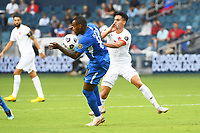 KANSASCITY, KS - JULY 11: Kevin Fortune #10 of Martinique with the ball shields the ball from Stephen Eustaquio #7 of Canada during a game between Canada and Martinique at Children's Mercy Park on July 11, 2021 in KansasCity, Kansas.