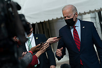 United States President Joe Biden speaks to the media before departing the White House in Washington, DC, February 27, 2021 for a trip to Wilmington, DE. Credit: Chris Kleponis / Pool via CNP /MediaPunch