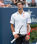 Novak Djokovic (SRB) defeats Sam Querrey (USA) 6-3, 6-2, 6-2 at the US Open being played at USTA Billie Jean King National Tennis Center in Flushing, NY on August 30, 2014