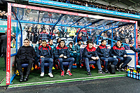 (L-R) Swansea manager Carlos Carvalhal, Joao Mario, coach, Bruno Lage, coach, goalkeeping coach Tony Roberts, physiotherapist, Ritson Lloyd and doctor Jez McCluskey on the bench during the Premier League match between Huddersfield Town and Swansea City and at the John Smith's Stadium Huddersfield, England, UK. Saturday 10 March 2018