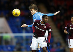 St Johnstone v Hearts..19.12.15  SPFL  McDiarmid Park, Perth<br /> Murray Davidson gets above Arnaud Djoum<br /> Picture by Graeme Hart.<br /> Copyright Perthshire Picture Agency<br /> Tel: 01738 623350  Mobile: 07990 594431