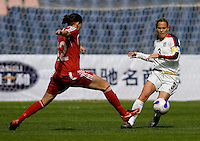 Canada forward (12) Christine Sinclair (12) stretches for the ball in front of USA captain (3) Christie Rampone during the Four Nations Tournament in Guangzhou, China on January 16, 2008. The United States defeated Canada 4-0.