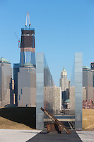 The rising One World Trade Center (Freedom Tower) and other buildings in lower Manhattan provide the backdrop for this view of the New Jersey 9/11 Empty Sky Memorial.  The lines of the memorial point to the empty sky left by the Twin Towers in the wake of the events of September 11, 2001.  The memorial, which honors the New Jersey residents lost that day, is located in Liberty State Park in Jersey City, New Jersey.