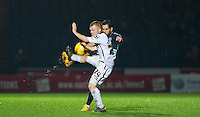 Sam Wood of Wycombe Wanderers clears from Adam Campbell of Notts County during the Sky Bet League 2 match between Wycombe Wanderers and Notts County at Adams Park, High Wycombe, England on 15 December 2015. Photo by Andy Rowland.