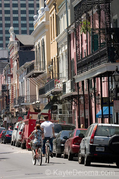Two bicyclists ride through the French Quarter down Royal Street toward the Central Business District in New Orleans, LA - April 2006