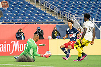 FOXBOROUGH, MA - MAY 16: Eloy Room #1 Columbus SC comes out to retrieve the ball under pressure from Tajon Buchanan #17 of New England Revolution during a game between Columbus SC and New England Revolution at Gillette Stadium on May 16, 2021 in Foxborough, Massachusetts.