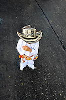 A Colombian boy, wearing a traditional Caribbean clothes and the Vueltiao hat, walks alone during the Carnival in Barranquilla, Colombia, 26 February 2006. The Carnival of Barranquilla is a unique festivity which takes place every year during February or March on the Caribbean coast of Colombia. A colourful mixture of the ancient African tribal dances and the Spanish music influence - cumbia, porro, mapale, puya, congo among others - hit for five days nearly all central streets of Barranquilla. Those traditions kept for centuries by Black African slaves have had the great impact on Colombian culture and Colombian society. In November 2003 the Carnival of Barranquilla was proclaimed as the Masterpiece of the Oral and Intangible Heritage of Humanity by UNESCO.