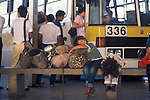 Homeless family with possessions at bus station sleeping. Brasilia Brazil South America. 1980s  1985