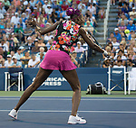 Venus Williams (flowered dress) partners with sister Serena  in doubles match at the US Open being played at USTA Billie Jean King National Tennis Center in Flushing, NY on August 29, 2013