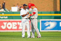 Torii Hunter (48) of the Detroit Tigers shakes hands with Mike Trout (27) of the Los Angeles Angels prior to their game at Comerica Park on June 25, 2013 in Detroit, Michigan.  The Angels defeated the Tigers 14-8.  (Brian Westerholt/Four Seam Images)
