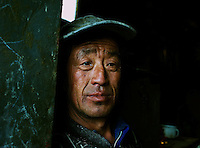 "A worker, at  a""rare-earth"" processing plant near Bayon Obo, Inner Mongolia.  The plant conducts first stage processing in extremely toxic conditions where workers complain of acid burns and sores as well as head-aches. The production of ""rare-earths"" is an extremely poisenous process with plants in the U.S. being closed due to environmental concerns. China accounts for some 97% of rare earth consumed world-wide. The ""rare earth elements"" are a group of 17 elements that are essential in 25% of modern technology including cell phones, computer hard discs, and electric motors and inparticular green technology such as electric batteries and wind turbines."