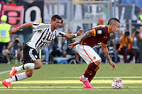 Calcio, Serie A: Roma vs Juventus. Roma, stadio Olimpico, 30 agosto 2015.<br /> Roma's Radja Nainggolan, right, is chased by Juventus' Stefano Sturaro during the Italian Serie A football match between Roma and Juventus at Rome's Olympic stadium, 30 August 2015.<br /> UPDATE IMAGES PRESS/Riccardo De Luca