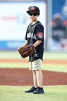A local youth waits to throw out the first pitch prior to the start of the Southern League game between the Montgomery Biscuits and the Chattanooga Lookouts on May 26, 2018 at AT&T Field in Chattanooga, Tennessee. (Andy Mitchell/Four Seam Images)
