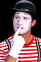 Portrait of colorful clowns in makeup for show to be funny for children acting as mim