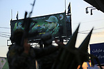 Palestinian militants from the Al-Quds Brigades, the armed wing of the Islamic Jihad movement, take part in a military parade, in support of prisoners on hunger strike held in Israeli jails in Gaza city on October 15, 2021. Photo by Dawoud Abo Alkas